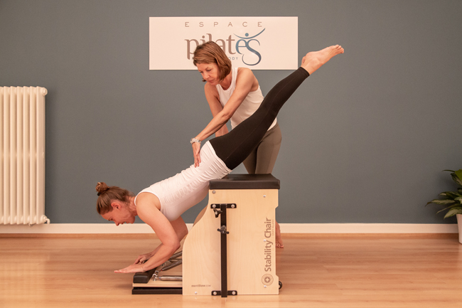 Pilates private training on stability chair machine in Lausanne - Espace Pilates Mind Your Body