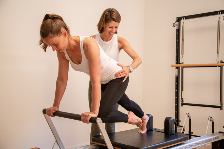 Pilates Lausanne studio private class on a reformer machine - Espace Pilates Mind Your Body
